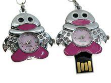 Флешка Uniq USB 2.0 ЧАСЫ Пингвин розовый [металл, камни] 4GB (04C17155U2)