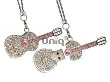 Флешка Uniq USB 2.0 Гитара Серебро / Розовый 4GB (04C35094U2)