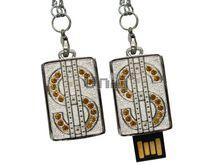 Флешка Uniq USB 2.0 ПАННО Сталь Доллар символ, желтый [металл, камни ] 4GB (04C35102U2)